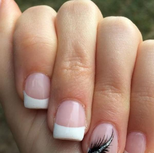 Feather look as great on nails as they do on hats. You can spice up your  classic french tip nails design by adding a black feather. - 76 Chic French Tip Nails Design That You Can Get Easily